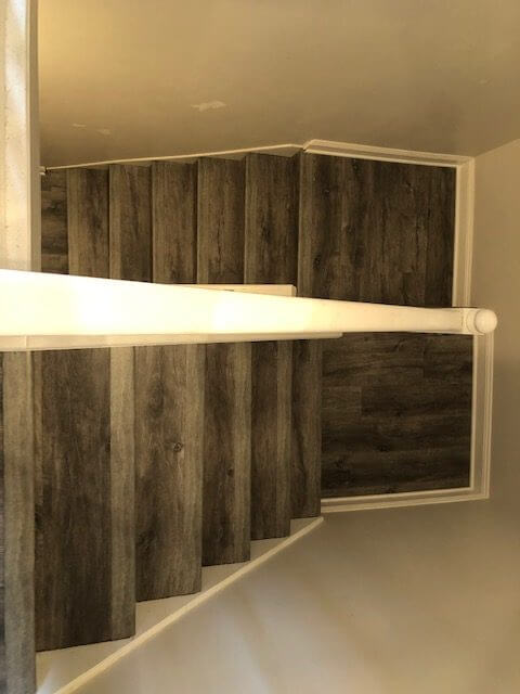 Stairs with hardwood flooring | Reinhold Flooring